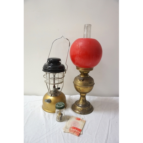 272 - TILLEY STORMLIGHT model X246B, with instructions, together with a gilt brass oil lamp with an opaque...