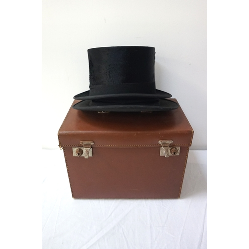 385 - GENTLEMAN'S BLACK TOP HAT marked to the interior Paisleys Limited of Glasgow, in a brown leather car...