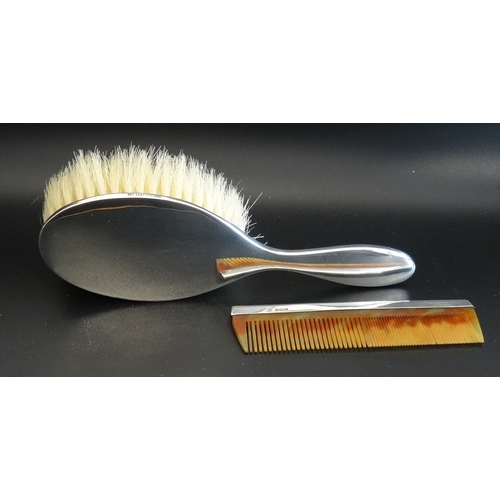 173 - EDWARD VII SILVER BACKED HAIR BRUSH and comb, both stamped Robinson & Co Ltd, Singapore and hallmark...