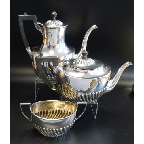 175 - EDWARD VII SILVER TEA SET comprising a tea pot, hot water pot and a twin handled sugar bowl, all wit...