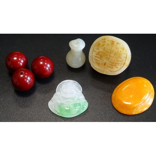 255 - SMALL SELECTION OF JADE AND AMBER  comprising three cherry amber beads, a jade seal, a small carved ...