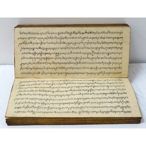 267 - 19TH CENTURY BURMESE BUDDHIST MANUSCRIPT of concertina form with khoi paper, each rectangular sheet ...