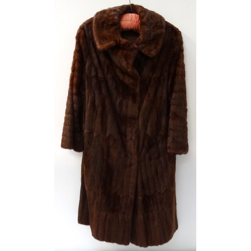 388 - LADIES RUSSIAN ERMINE COAT full length and marked to the collar 'Karter', together with a matching h...