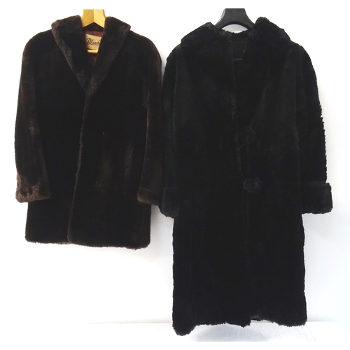 390 - LADIES CONEY FUR COAT in black with elaborate detail to the lining, together with a 'Blandmore' arti...