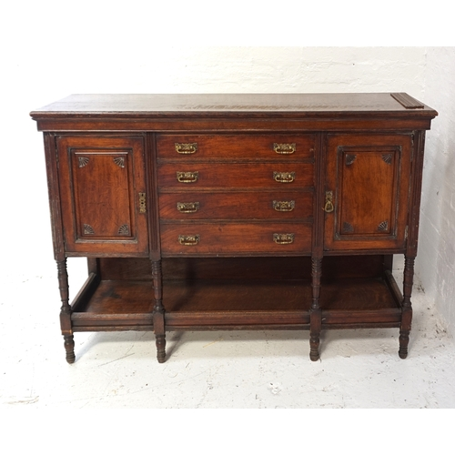 513 - 18th CENTURY STYLE OAK DRESSER BASE with a moulded top above four central drawers flanked by a pair ...