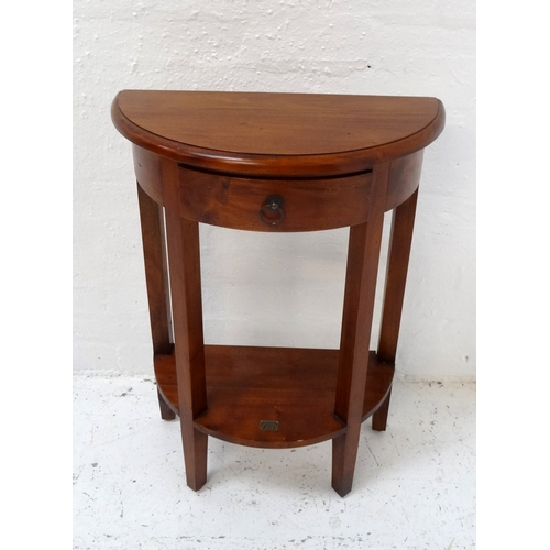 480 - ANCIENT MARINER TEAK SIDE TABLE with a moulded D shape top above a frieze drawer, on four shaped sup...