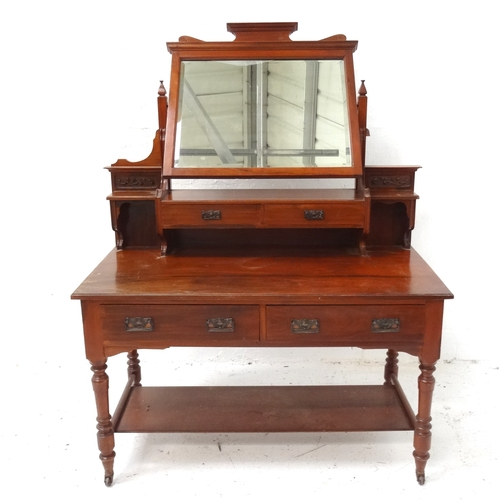 510 - MAPLE & CO. EDWARDIAN MAHOGANY DRESSING TABLE with a shaped bevelled mirror above two central short ...