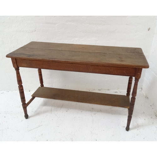 511 - EDWARDIAN PINE SIDE TABLE with a moulded plank top, standing on turned tapering supports united by a...