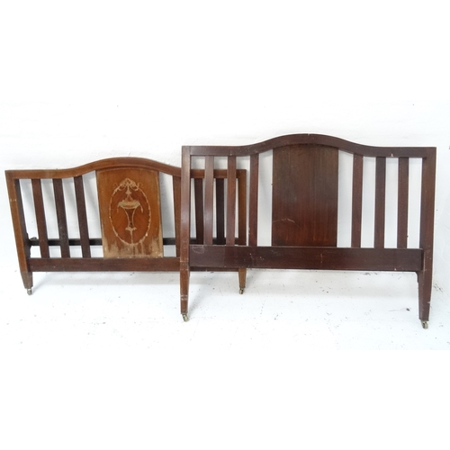 515 - EDWARDIAN MAHOGANY DOUBLE BED with a shaped and slatted head and footboard, inlaid with floral swags...