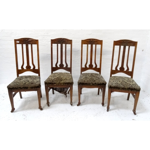 517 - SET OF FOUR OAK ARTS AND CRAFTS DINING CHAIRS with shaped carved top rails above shaped and carved s...