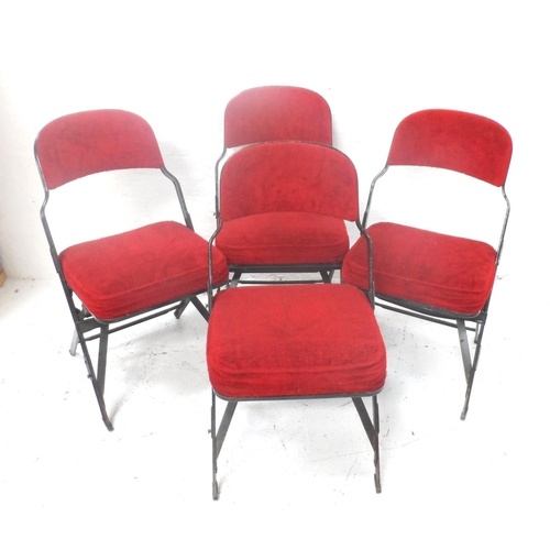 502 - FOUR FOLDING METAL FRAME CHAIRS with shaped padded backs and seats, covered in a plush red material ...