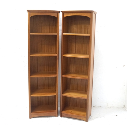 481 - PAIR OF NATHAN TEAK BOOKCASES each with a moulded top above four shelves, 183.5cm x 54cm (2)...