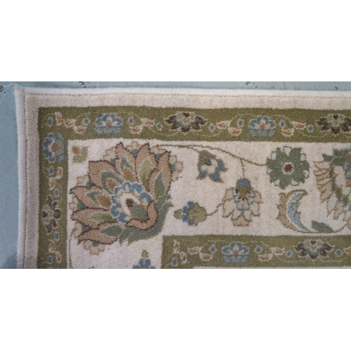 483 - GOOCH WOBURN WOOL RUG the mushroom coloured ground decorated with floral motifs and encased by a dar...