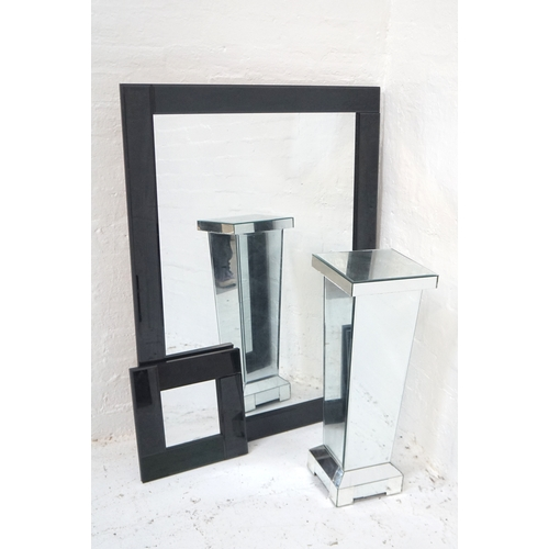 504 - LARGE BLACK GLOSS FRAMED MIRROR 116cm high x 85.5cm wide; a smaller matching example, 35cm x 35.5cm;...