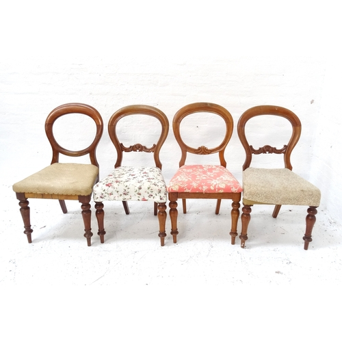 518 - HARLEQUIN SET OF FOUR VICTORIAN BALLOON BACK DINING CHAIRS with stuffover seats, standing on turned ...