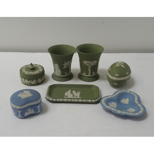 219 - SELECTION OF WEDGWOOD JASPERWARE comprising a pair of green ground trumpet vases, two section egg, p...