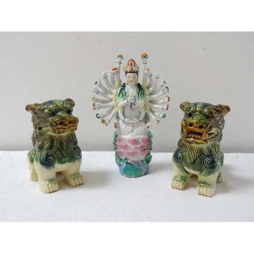 228 - PORCELAIN FIGURINE OF THE HINDU GODDESS DURGA in traditional pose, raised on a lotus leaf base, 20.5...
