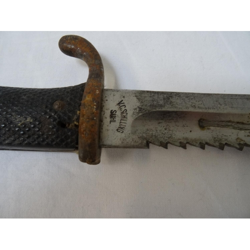 423 - WORLD WAR I SAWBACK BAYONET the blade marked V.C. Schilling, Suhl, the single edged 25cm blade with ...