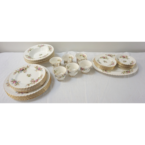216 - ROYAL ALBERT MOSS ROSE DINNER SERVICE comprising dinner plates, soup bowls, side plates, dessert pla...