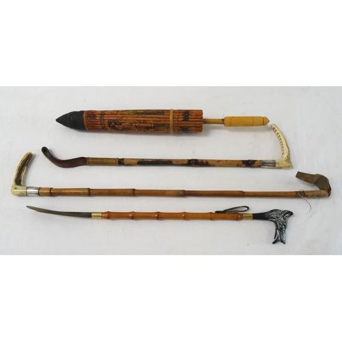 270 - SEGMENTED BAMBOO RIDING CROP with a horn handle and silver collar, 78.5cm long, a similar riding cro...