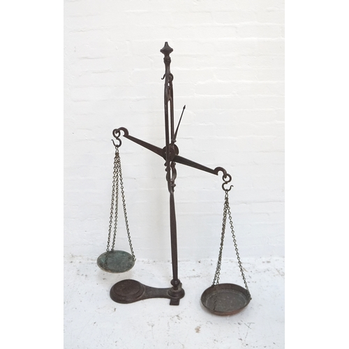 277 - SET OF VICTORIAN CAST IRON SHOP SCALES the central balance arm with two chain link weighing bowls, r...