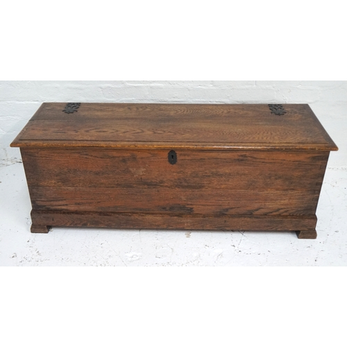 497 - OAK COFFER with a moulded lift up lid with decorative false hinges, side carrying handles and standi...