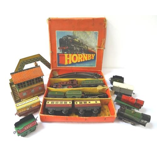 418 - LARGE SELECTION OF CLOCKWORK 'O' GAUGE RAILWAY including the Hornby Goods Set No; 20 boxed, together...
