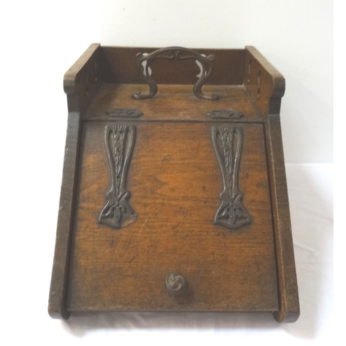 558 - ARTS AND CRAFTS OAK COAL SCUTTLE with a shaped metal handle encased by a three quarter pierced galle...