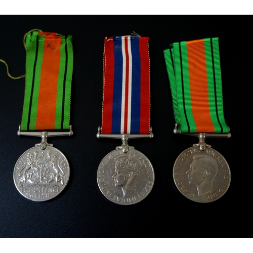 430 - TWO WORLD WAR II GEORGE VI DEFENCE MEDALS with ribbons together with a World War II medal and ribbon...