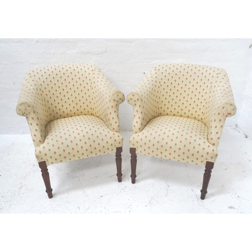 564 - PAIR OF MODERN TUB ARMCHAIRS covered in an ivory ground material with terracotta and green fleur de ...