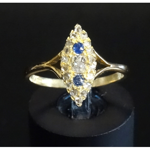 33 - VICTORIAN SAPPHIRE AND DIAMOND CLUSTER DRESS RING in navette shaped setting, the central diamond wit...