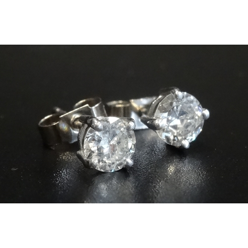 57 - PAIR OF DIAMOND STUD EARRINGS the round brilliant cut diamonds totalling approximately 0.9cts, in ei...