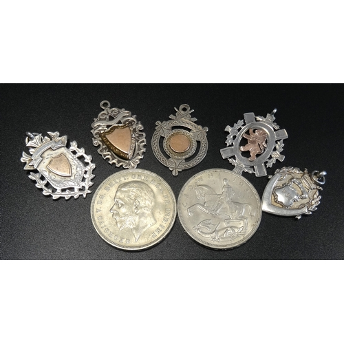 181 - FIVE SILVER MEDAL FOBS four with gold detail, one with Gaelic inscription dated 1939 to reverse, and...
