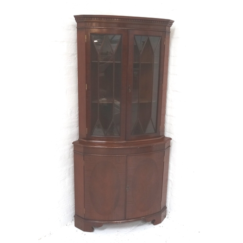 566 - GEORGIAN STYLE MAHOGANY CORNER CABINET with a moulded dentil cornice above a pair of glazed doors, w...