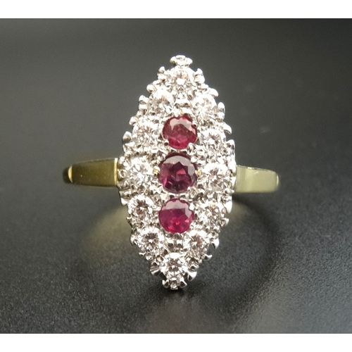 7 - ART DECO STYLE DIAMOND AND RUBY CLUSTER RING the three central vertically set rubies in navette shap...