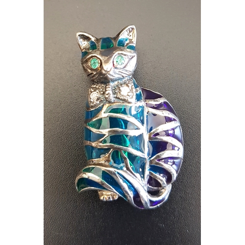 20 - DIAMOND AND EMERALD SET CAT BROOCH with colourful filled panels to the body, with emerald eyes and d...