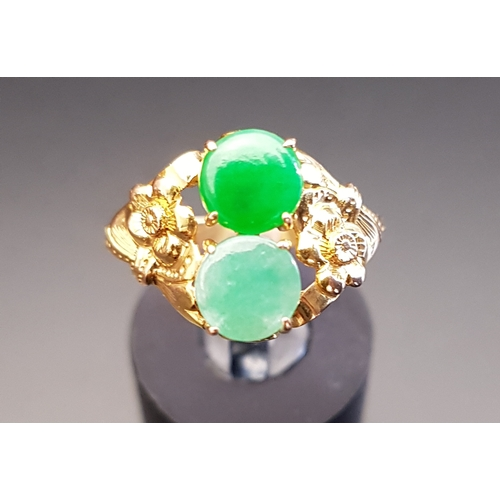 25 - JADE AND JADE COLOURED HARDSTONE RING the darker green jade and lighter hardstone within floral deco...
