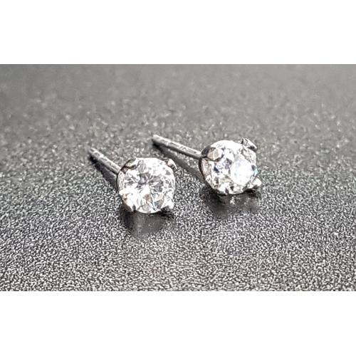 42 - PAIR OF DIAMOND STUD EARRINGS the round brilliant cut diamonds approximately 0.25cts each, in nine c...