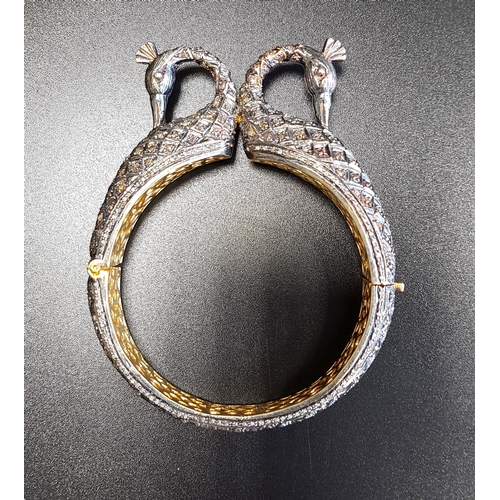 48 - ORNATE DIAMOND SET PEACOCK DESIGN BANGLE the highly decorative hinged bangle with double peacock hea...