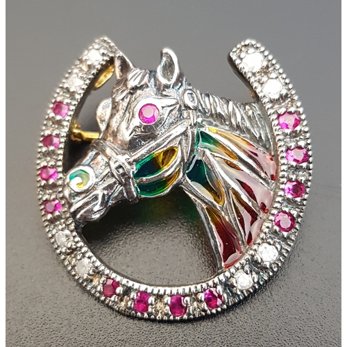 69 - DIAMOND AND RUBY SET HORSE BROOCH the horse with colourful filled panels and ruby eyes, within diamo...