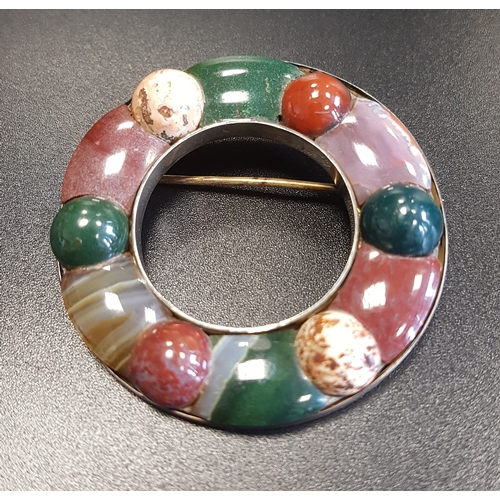 82 - CIRCULAR SCOTTISH PEBBLE BROOCH with various coloured agate sections, in unmarked silver, 4.5cm diam...