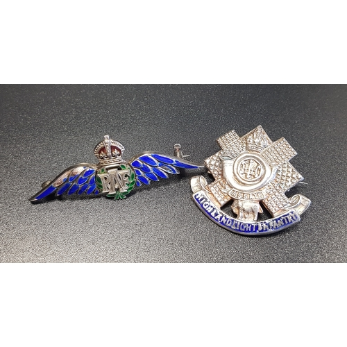 131 - TWO SILVER AND ENAMEL DECORATED MILITARY BROOCHES comprising an RAF sweetheart brooch; and a Highlan...