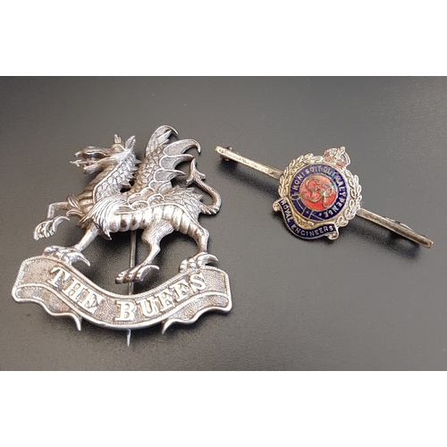 134 - UNMARKED SILVER 'BUFFS' DRAGON BROOCH the dragon standing on a ribbon marked 'The Buffs'; together w...