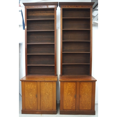 552 - PAIR OF LARGE EDWARDIAN OAK AND MAHOGANY LIBRARY BOOKCASES each with a moulded dentil cornice with f...