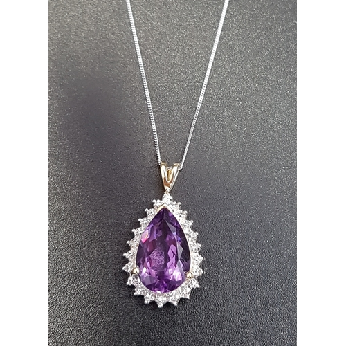 73 - AMETHYST AND DIAMOND DROP PENDANT the central pear cut amethyst within illusion setting with four sm...