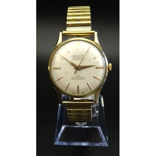 35 - GENTLEMAN'S ACCURIST NINE CARAT GOLD CASED WRISTWATCH circa 1958, the 21 jewel automatic wristwatch ...