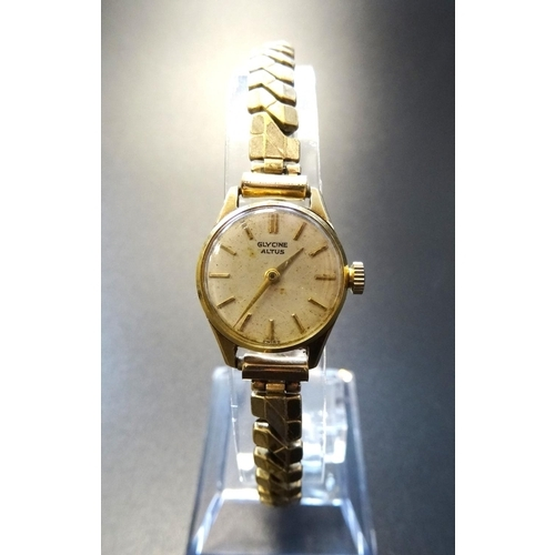 65 - LADIES FOURTEEN CARAT GOLD CASED GLYCINE ALTUS WRISTWATCH the dial with baton five minute markers, o...