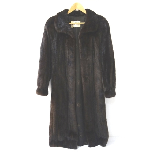 406 - LADIES FULL LENGTH MINK COAT with side pockets and trade label for 'Moray Glasser of Glasgow'...