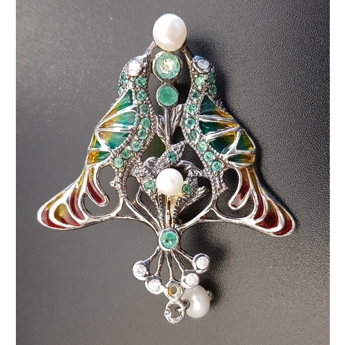 27 - UNUSUAL DIAMOND, EMERALD AND PEARL SET BIRD BROOCH with colourful filled panels to represent the fea...