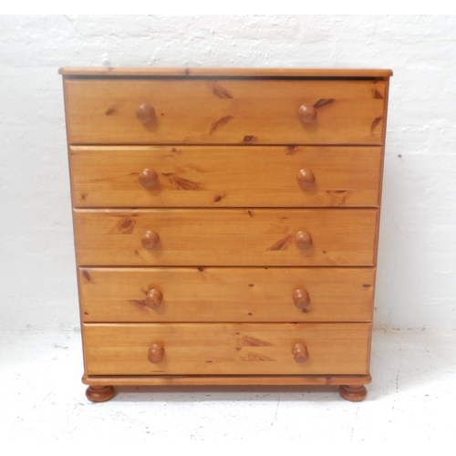 545 - PAIR OF PINE BEDSIDE CHESTS with moulded tops above four drawers with turned handles, standing on fl...